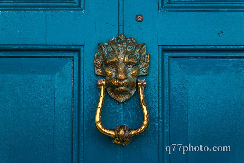 Brass lion head knocker, knocker on blue wooden door, decorative