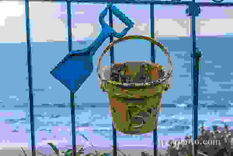 Metal ornament on a balustrade in a seaside village, a symbolic