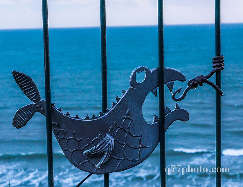 metal ornament on a balustrade in a seaside village, symbolic in