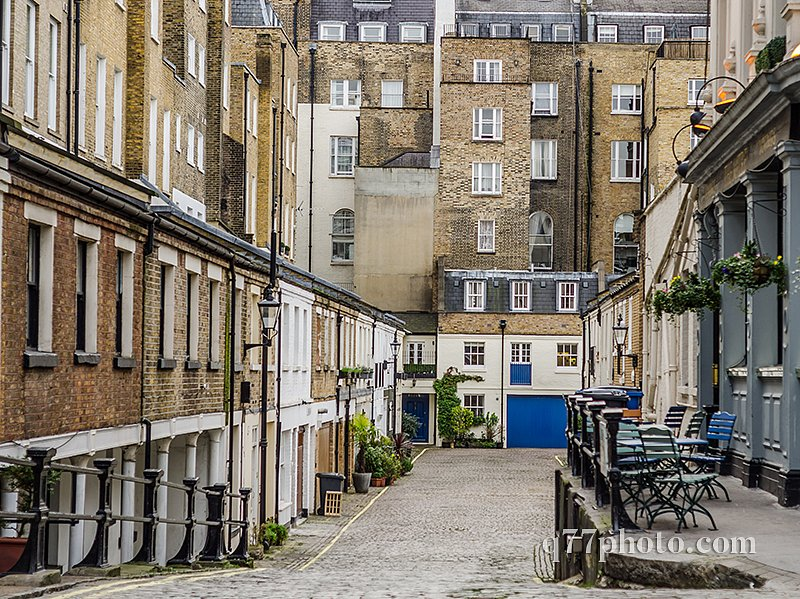 narrow passage to the streets with buildings low-rise buildings,
