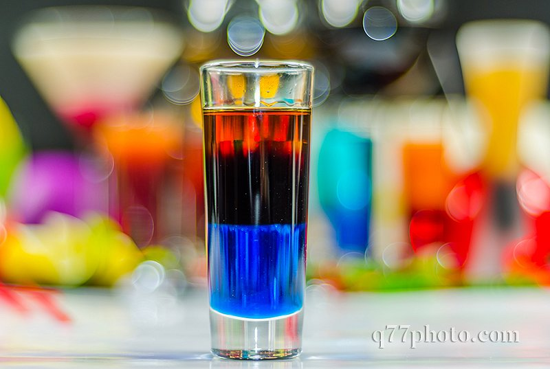 colored drink in glass for shots, a combination of blue with red