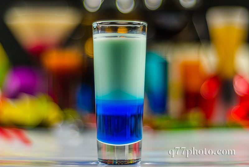 colored drink in glass for shots, a combination of white with bl
