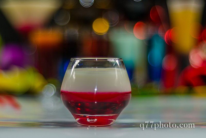 colored drink in glass for shots, a combination of white with re