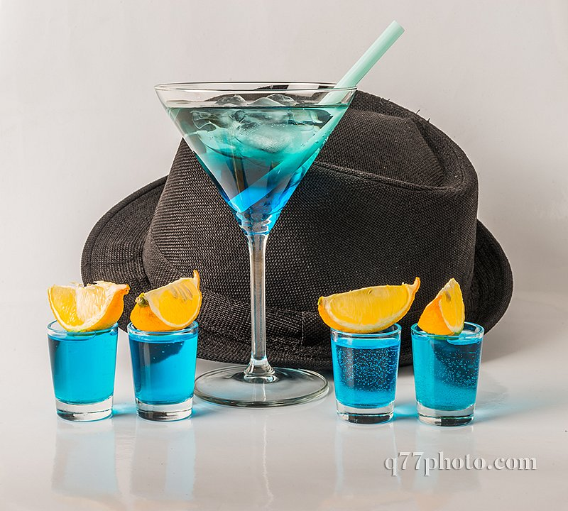 Colorful drink in a martini glass, blue and green combination, f