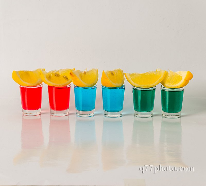 Glasses with blue, green and red kamikaze, glamorous drinks, mix