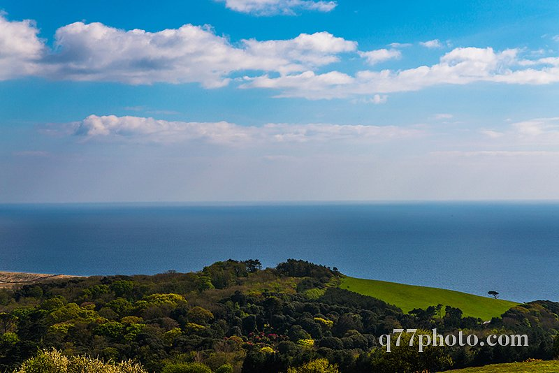 Ocean view with hills, green vegetation background and beautiful