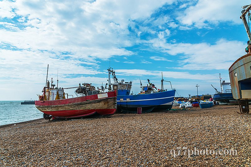 Fishing boats on the shore, pebble beach, wooden boats, fishing