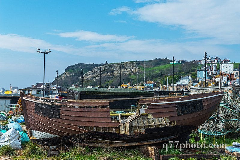 old wooden destroyed boat in a fishing port, on the shore, again